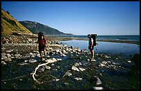 Backpackers cross a stream, Lost Coast. California, USA ( color)