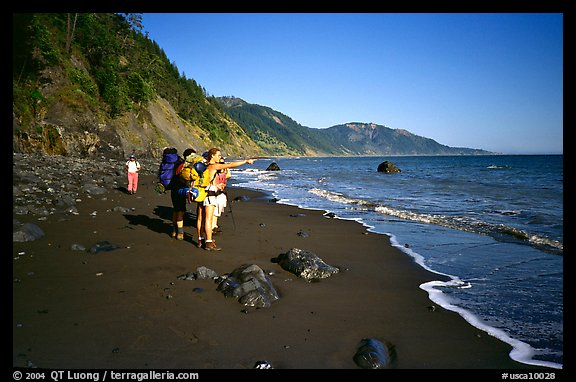 Backpackers on the beach,  Lost Coast. California, USA (color)