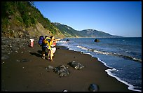 Backpackers on the beach,  Lost Coast. California, USA ( color)