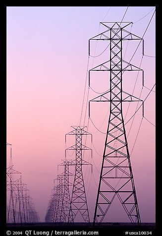 High tension power lines at dusk. California, USA