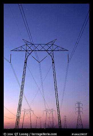 High voltage power lines at sunset. California, USA