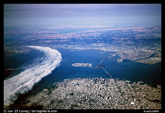 Aerial view of narrow band of fog rolling in from the Golden Gate besides the city. San Francisco, California, USA