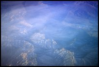 Aerial view of desert mountains with thin clouds. California, USA (color)