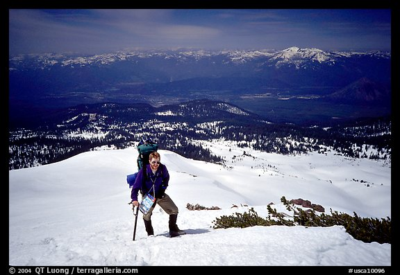 Climber takes a break on the Green Ridge of Mt Shasta. California, USA (color)