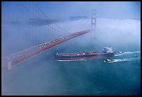 Tanker ship cruising under the Golden Gate Bridge in the fog. San Francisco, California, USA (color)