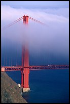 Golden Gate bridge with top covered by fog. San Francisco, California, USA (color)