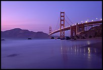 Golden Gage bridge at dusk, reflected in wet sand at East Baker Beach. San Francisco, California, USA ( color)