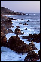 Coastline with pointed rocks and surf, sunset, Garapata State Park. Big Sur, California, USA (color)