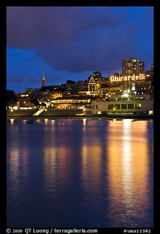 Lights of Ghirardelli Square sign reflected in Aquatic Park. San Francisco, California, USA