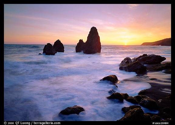 Wave action, seastacks and rocks with sun setting, Rodeo Beach. California, USA (color)