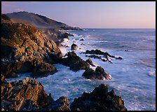 Surf and rocks at sunset, near Rocky Cny Bridge, Garapata State Park. Big Sur, California, USA