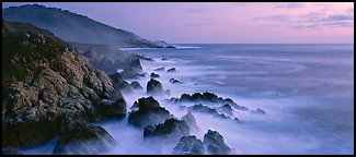 Seascape with pastel colors, rocks, and surf. Big Sur, California, USA (Panoramic color)