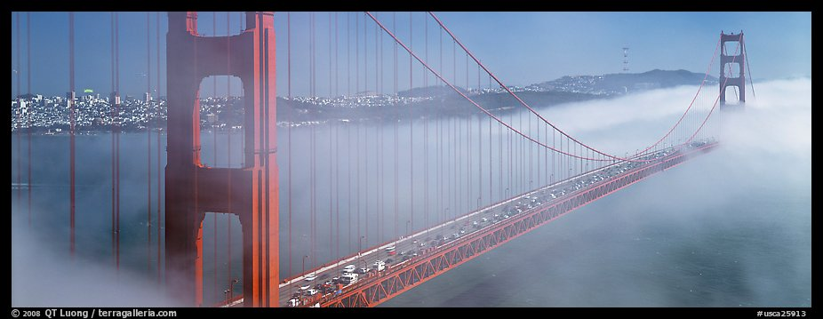 Fog rolling over Golden Gate Bridge. San Francisco, California, USA (color)
