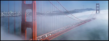 Fog rolling over Golden Gate Bridge. San Francisco, California, USA (Panoramic color)