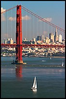 Sailboat, Golden Gate Bridge, and  city skyline, afternoon. San Francisco, California, USA (color)