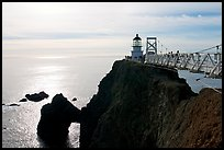 Narrow bridge leading to the Point Bonita Lighthouse, afternoon. California, USA