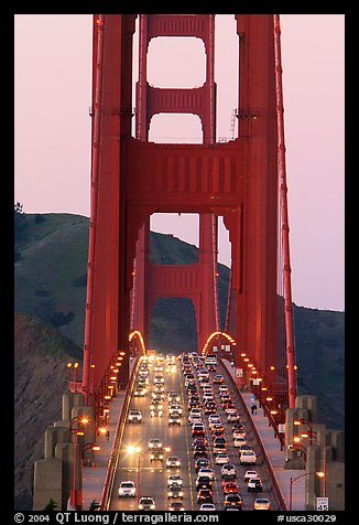 Traffic on Golden Gate Bridge at sunset. San Francisco, California, USA (color)