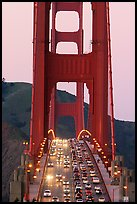 Traffic on Golden Gate Bridge at sunset. San Francisco, California, USA