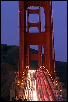 Traffic on Golden Gate Bridge at dusk. San Francisco, California, USA
