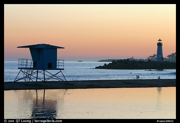 Beach cabin and lighthouse, Twin Lakes State Beach, sunset. Santa Cruz, California, USA (color)