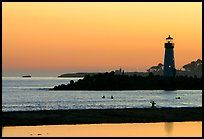 Lighthouse and Surfers in the water at sunset. Santa Cruz, California, USA ( color)