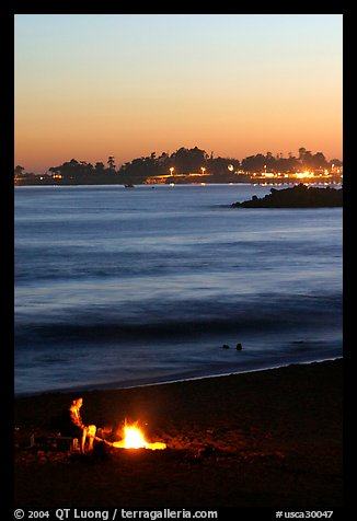 Bonfire on the beach at sunset. Santa Cruz, California, USA (color)