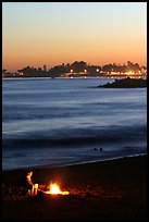 Bonfire on the beach at sunset. Santa Cruz, California, USA ( color)