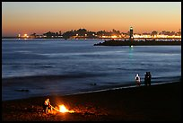 Beach campfire at sunset. Santa Cruz, California, USA (color)