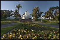 Flower bed and Conservatory of the Flowers, late afternoon, Golden Gate Park. San Francisco, California, USA (color)