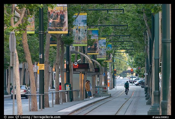 Downtown tree-lined street with tram lane. San Jose, California, USA (color)