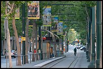 Downtown tree-lined street with tram lane. San Jose, California, USA ( color)