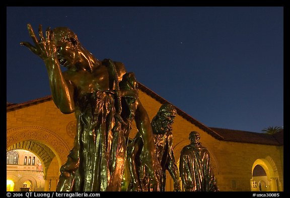 Burghers of Calais sculptures in  Quad at night. Stanford University, California, USA (color)