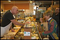 Choosing cheese at the Cheese Board. Berkeley, California, USA (color)
