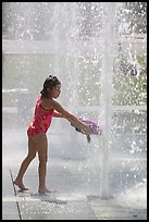 Girl refreshing herself, Cesar de Chavez Park. San Jose, California, USA