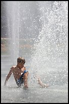 Boy playing in water,  Cesar de Chavez Park. San Jose, California, USA (color)