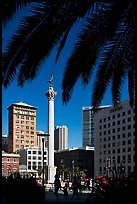 Union square and column framed by palm trees, afternoon. San Francisco, California, USA (color)