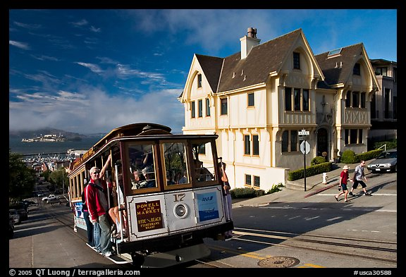 Cable car climbing, and Tudor house, late afternoon. San Francisco, California, USA (color)