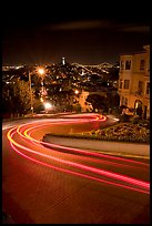 Light trails on the crooked section of Lombard Street at night. San Francisco, California, USA