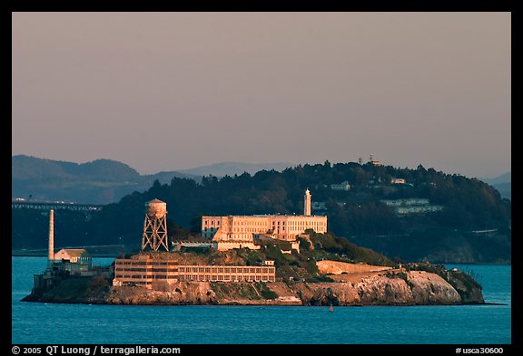 Alcatraz Island at sunset, with Yerba Buena Island in the background. San Francisco, California, USA (color)