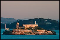 Alcatraz Island at sunset, with Yerba Buena Island in the background. San Francisco, California, USA