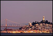 Telegraph Hill and Bay Bridge at dusk. San Francisco, California, USA (color)
