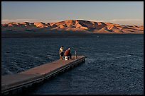 Fishing on San Luis Reservoir at sunset. California, USA