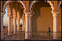 Indian girl running amongst columns of the Sikh Temple. San Jose, California, USA (color)