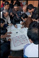 Vietnamese immigrants playing Chinese chess in a patio. San Jose, California, USA (color)