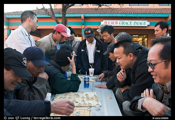 Vietnamese immigrants at a Chinese chess game. San Jose, California, USA (color)