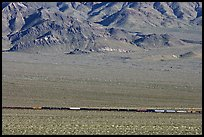Freight train in desert valley. Mojave National Preserve, California, USA (color)