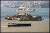 Cargo ships and Alcatraz Island in the San Francisco Bay. San Francisco, California, USA