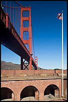 Fort Point courtyard, flag pole, and Golden Gate Bridge. San Francisco, California, USA