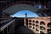 Fort Point courtyard, lighthouse,  and arch of the Golden Gate Bridge. San Francisco, California, USA