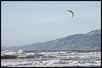 Kite surfer in Pacific Ocean waves, afternoon. San Francisco, California, USA